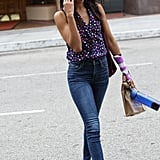 Zoe Saldana had ample styling fodder for the transitional weather — a sweet silky button-down and high-waist jeans.