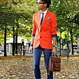 Orange you glad we spotted this polished guy? Garner the color inspiration to dress up your denim with a preppy-cool blazer washed in one of the season's most eye-popping hues — extra points for geeky-chic specs.  Source: Lookbook.nu