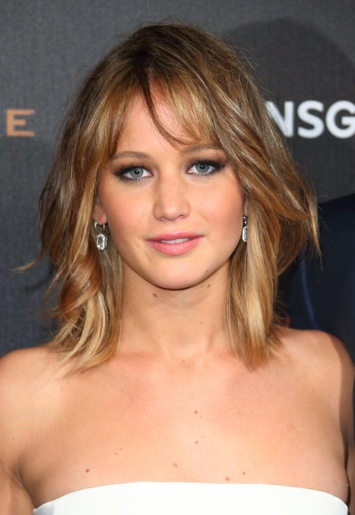 Jennifer Lawrence wore Chopard earrings.