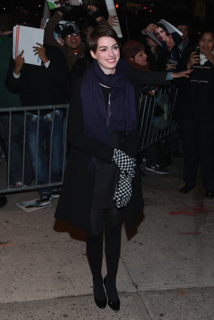 Anne Hathaway was greeted by a frenzy of fans as she arrived at The Daily Show With Jon Stewart in NYC last night. She stopped by the program to chat about her holiday hit, Les Misérables, and Jon praised her dramatic performance. Anne's work is getting award season recognition as well, including at tonight's National Board of Review Gala, where she and her costars will be honored for best cast and the project will be named among the best movies of the year. The winning may continue at Thursday's Critics' Choice Awards, where Anne's nomination for best supporting actress is just one of 11 nods for Les Mis.  Anne's red carpet run doesn't end there, since the Golden Globes are this Sunday — make sure to fill out our Golden Globes ballot for a chance to win an iPad Mini! We'll have to wait and see if her husband, Adam Shulman, joins her in front of the cameras, after they vacationed together in Switzerland over the New Year.