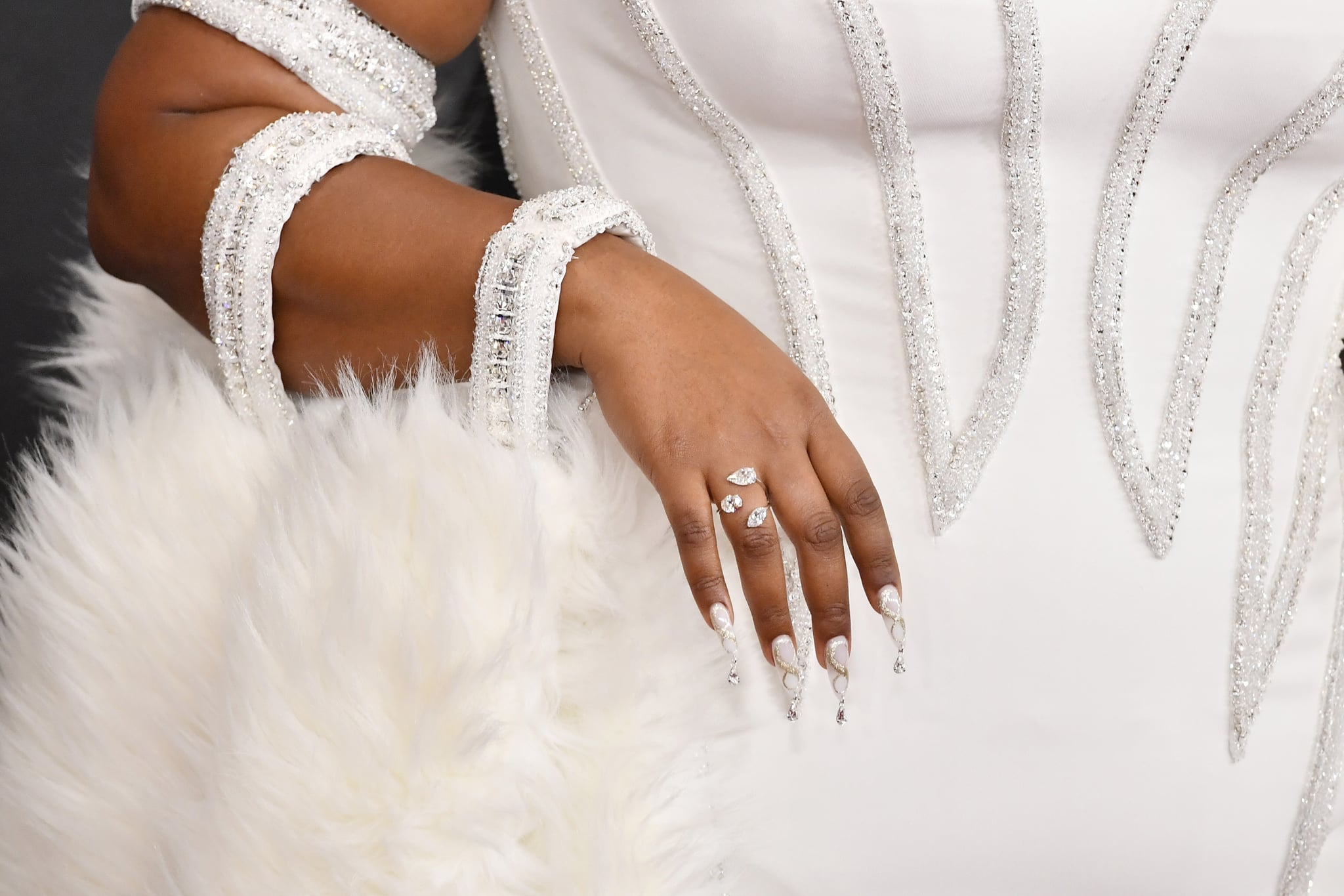 LOS ANGELES, CALIFORNIA - JANUARY 26: Lizzo, ring, manicure, purse, and fashion detail, attends the 62nd Annual GRAMMY Awards at STAPLES Centre on January 26, 2020 in Los Angeles, California. (Photo by Frazer Harrison/Getty Images for The Recording Academy)
