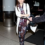 Emilia's off-duty look is just as spotless as her red-carpet style. While arriving at LAX airport, she worked prints in a Dries Van Noten Spring 2013 outfit, topped with a fresh white coat.
