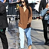While in LA, Zoë made a baggy button-down shirt look more feminine with yellow kitten heels.