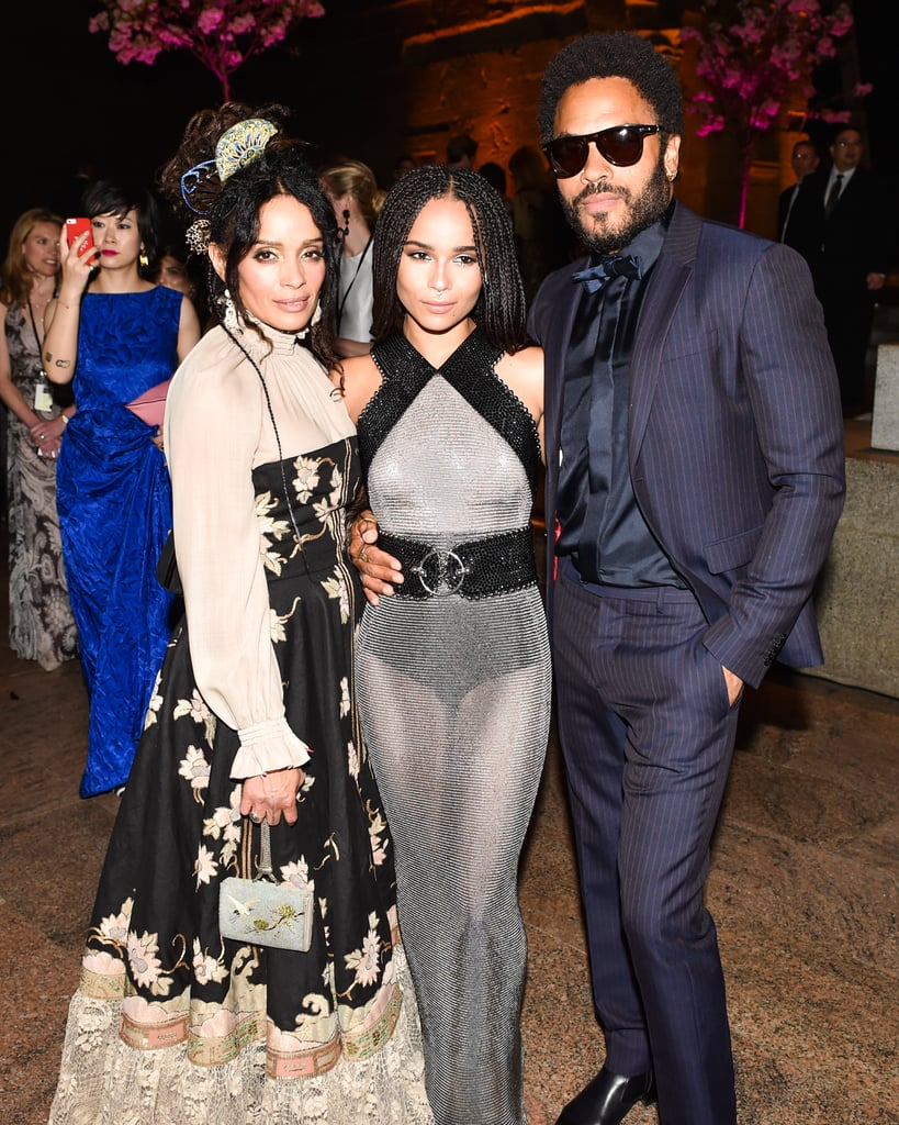 It goes without saying that Zoë Kravitz is probably one of the most genetically blessed women in Hollywood — as the only daughter of rocker Lenny Kravitz and actress Lisa Bonet, 28-year-old Zoë not only inherited her parents' good looks, but also their talent (and while she's not technically related to her stepdad, Jason Momoa, Zoë still shares his edgy sense of style and taste in tattoos). She's risen to fame both on screen in films like Mad Max: Fury Road, Dope, and the Divergent series and also showcases her musical prowess on stage with her band, Lolawolf. If that wasn't cool enough, Zoë also surrounds herself with ultracool, high-profile fashion designers and fellow starlets and has dated hot celebrity guys like Penn Badgley, Chris Pine, Drake, and her current beau, Karl Glusman. Lenny and Lisa were married from 1987 to 1993, but despite splitting, they've remained some of the most amicable exes ever. They are regularly spotted on outings around LA and even attended the Met Gala together in 2015 — and of course, they can also be counted on to link up to support Zoë at her concerts and movie premieres. We've rounded up the best photos of Zoë and her parents, just in case you needed further proof that her laid-back, rocker-cool attitude and stunning good looks don't fall far from the tree. Keep reading to see them all now.