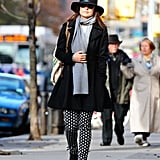 Olivia bundled up in a flared black peacoat, light blue cardigan, and arrow-print Rag & Bone trousers ($495). She topped off her street-chic style with the same scarf and sunnies, then tossed on this Rag & Bone fedora ($175) to up the cool factor.