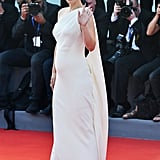 For the actual red carpet at the 73rd Venice Film Festival, she chose a one-shoulder Dior gown to highlight her baby bump.