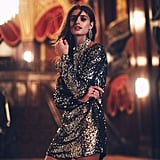 Taylor Hill wearing Free People's Tarnished Gold Sequin Tunic ($298).