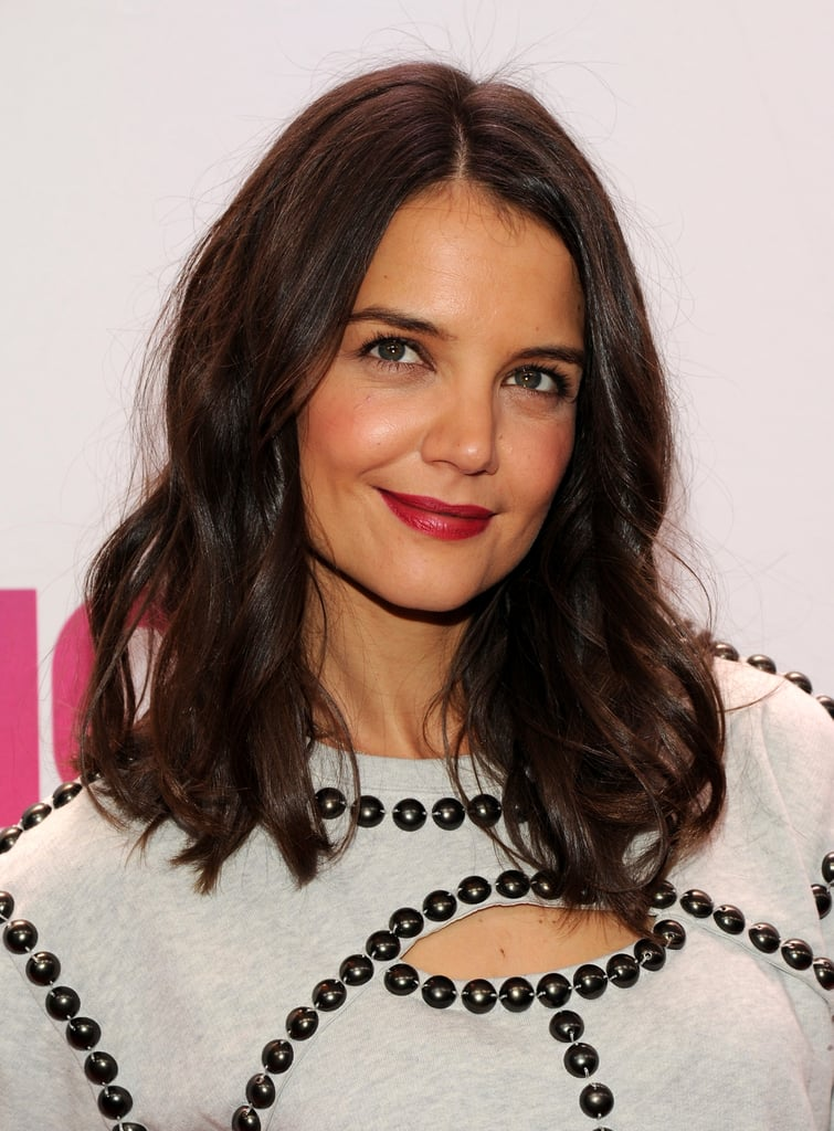 Katie Holmes's dark brown hue pairs gorgeously with a classic red lip, no?