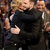 Justin Timberlake and Ellen DeGeneres hugged at the People's Choice Awards in January 2014.