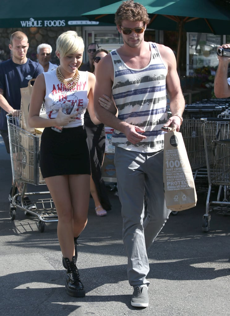 "Miley Cyrus's engagement ring was on display as she and her fiancé, Liam Hemsworth, stopped at an LA Whole Foods yesterday. She showed off her legs in a short skirt, paired with Doc Martens, on the outing. Miley was in a great mood, too — she tweeted, ""I love my fiancé."" When she met up with friends later on, Miley added, ""With my favorite people in the world — the love of my life, my fiancé, Cheyne Thomas, Paul Khoury, and Harrison Smart. Life is so good!""  Miley and Liam are reunited at home on the West Coast after he returned from Philadelphia, where he was on location shooting Paranoia opposite Amber Heard. Nineteen-year-old Miley made the trek across the country to visit her soon-to-be husband on set, but has also been busy with her own ventures. Miley stepped out solo for the MTV VMAs to promote her upcoming album."