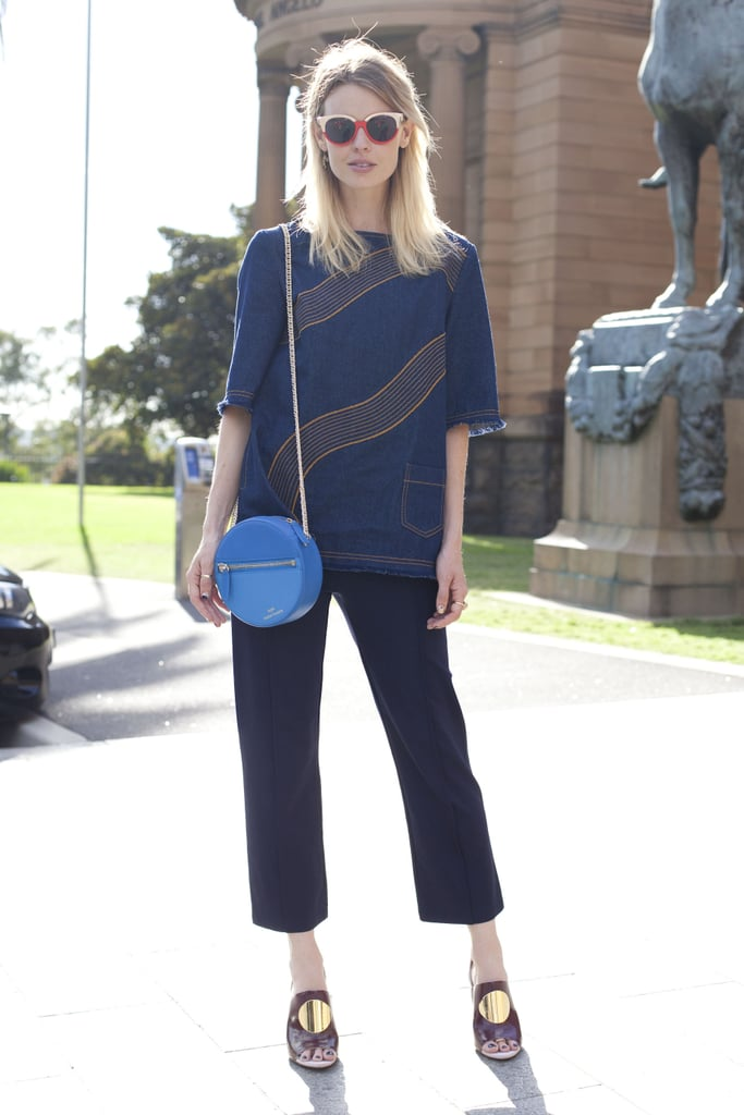 Take the denim trend to work, even if your office isn't blue-jean friendly, with a top. Then dress up the outfit with slick trousers and a pair of metallic heels for contrast.