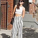 Skip the matching set and pair a crop top with high-waisted pants for a cool spin on hot weather style.