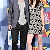 Kristen Stewart posed on the red carpet with Robert Pattinson in LA while wearing a hot minidress at the September 2008 MTV VMAs.