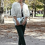 A textured bomber, metallics, and printed pants were all at play in this statement-maker's look.