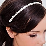 With just the right amount of bedazzle, this rhinestone bridal hairband ($46) pairs perfectly with or without a veil.