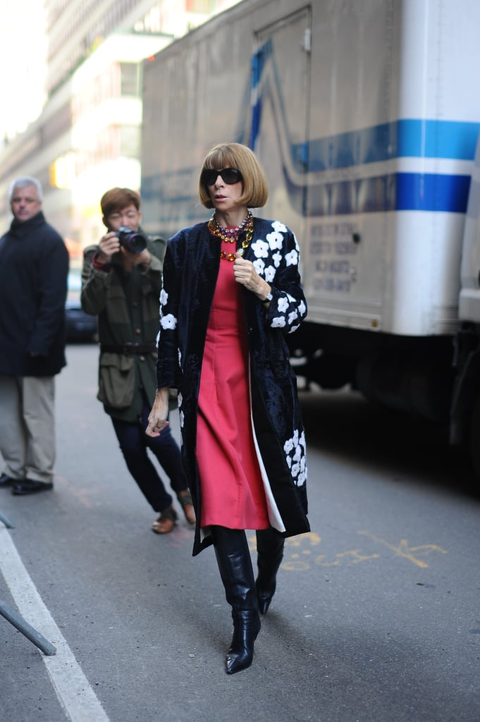 Anna Wintour dressed a pretty sheath and statement coat with knee-high boots.