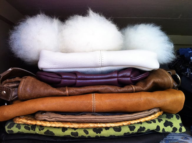 """""""Rotating"""" hand bags is something I used to do often, but not so much anymore. I store mine where I can see them (otherwise I forget what I have), piled up in the top of my cupboard."""