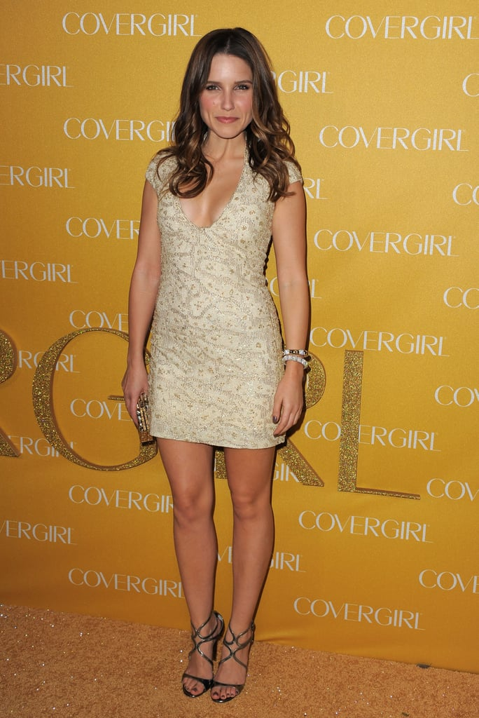 Sophia Bush played it cool in a low-cut, beige dress, strappy black heels, and Vhernier jewelry.