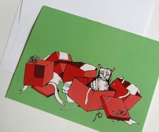 "This hilarious Holiday CatNote ($3) says on the inside, ""I hope your holiday season is as much fun as a cat in a pile of used wrapping paper."""