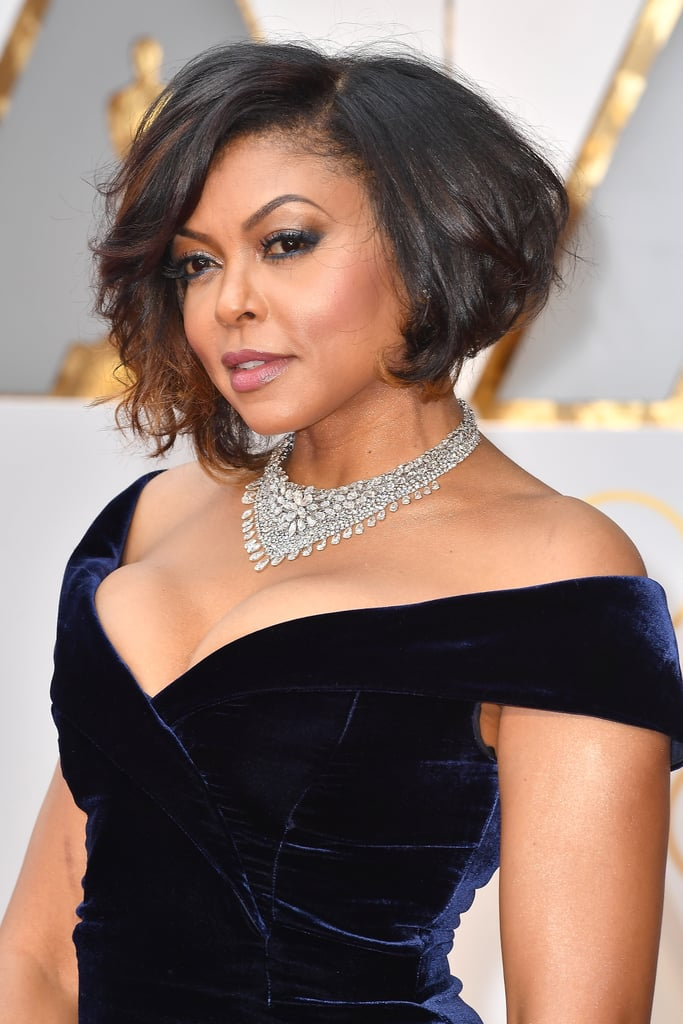 Taraji P. Henson looked gorgeous as usual when she took the red carpet at the 2017 Academy Awards. But zooming in on her look revealed an unexpected yet oh-so-glam makeup choice that we didn't notice at first glance: blue eyeliner.  Makeup artist Ashunta Sheriff used a navy Urban Decay 24/7 eye pencil on Taraji's upper and lower lash lines, which made for the perfect colour accent to her off-the-shoulder velvet dress. The finishing touches to her glowing makeup? Ashunta covered Taraji's body with St. Tropez's Self Tan Luxe Dry Oil for a hydrating sheen, and contoured her face using a 3-in-1 Bronzing Powder. With a few swipes of Glossier's newly launched Cloud Paint gel-cream blush on top, the Hidden Figures actress looked truly stunning. And let's not forget about her glam bob. Hair stylist Tymothe Wallace created her look by first spraying her strands with Dove Absolute Curls Leave-In Detangler before blowing them dry. He then applied Dove Absolute Curls Supreme Crème Serum for some added shine and softness.  To re-create Taraji's voluminous curls, Tymothe suggests using a curling iron to make pin curls and then setting them with Velcro rollers. Add in some extrastrong hair spray, and you'll be on your way to an Old Hollywood glamour look that's just as chic as Taraji's. Read on to get up close and personal with Taraji's sultry red carpet hair and makeup.