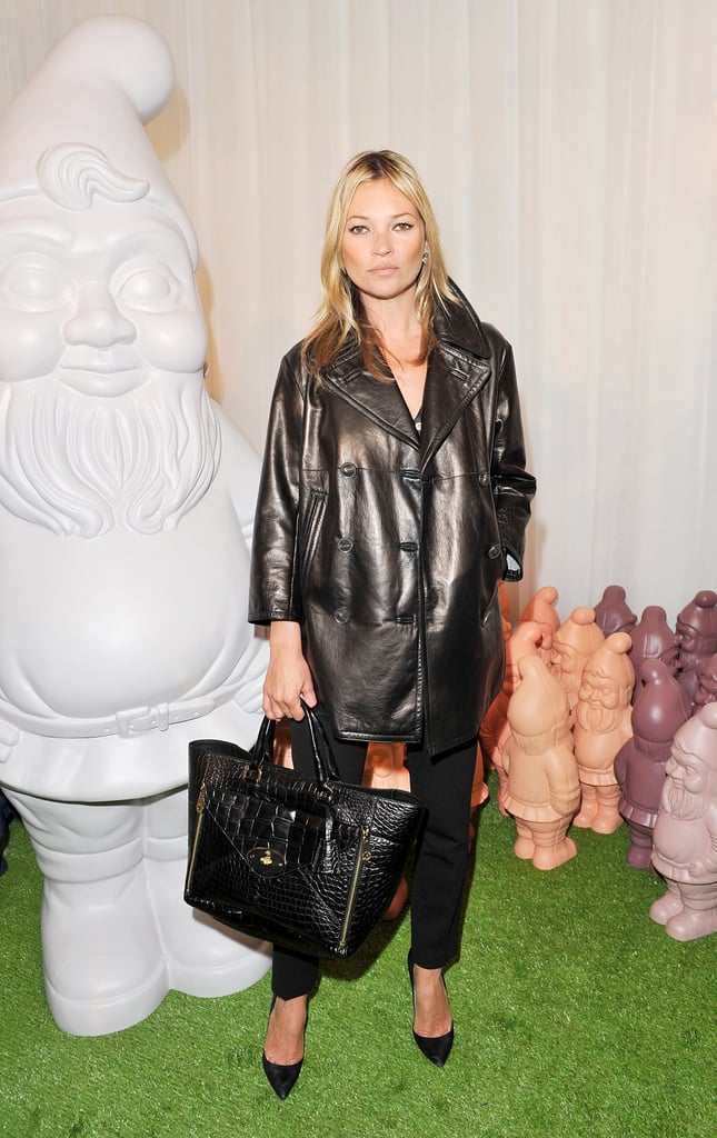 Kate Moss wore Mulberry's Peacoat in Black Bonded Leather, Shirt Blouse in Black Silk, Ankle Length Trousers in Black Wool, and carried the Willow Tote in Black Alligator from the Spring Summer 2013 Collection.