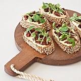 Appetizer: Hummus, Sun-Dried Tomato, and Pea Shoot Crostinis