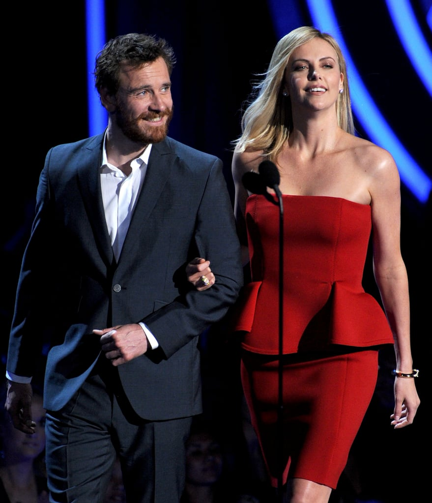 Hot big-screen pair Michael Fassbender and Charlize Theron presented an award.
