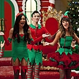 "Glee Santana (Naya Rivera), Kurt (Chris Colfer), and Rachel (Lea Michele) perform in Glee's holiday episode ""Previously Unaired Christmas,"" airing Dec. 5 on Fox."