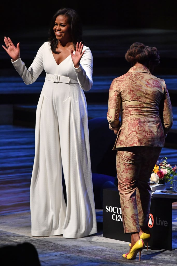 1aa295768d7 Michelle wore a white jumpsuit to speak with Nigerian novelist Chimamanda  Ngozi Adichie at the Royal