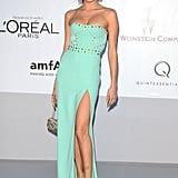 Isabeli Fontana donned a minty green gown, complete with thigh-high slit and rivet embellishments at the Cannes amfAR Gala.