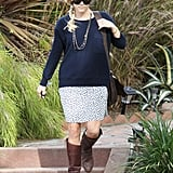 Reese Witherspoon paired a navy sweater with a printed skirt.