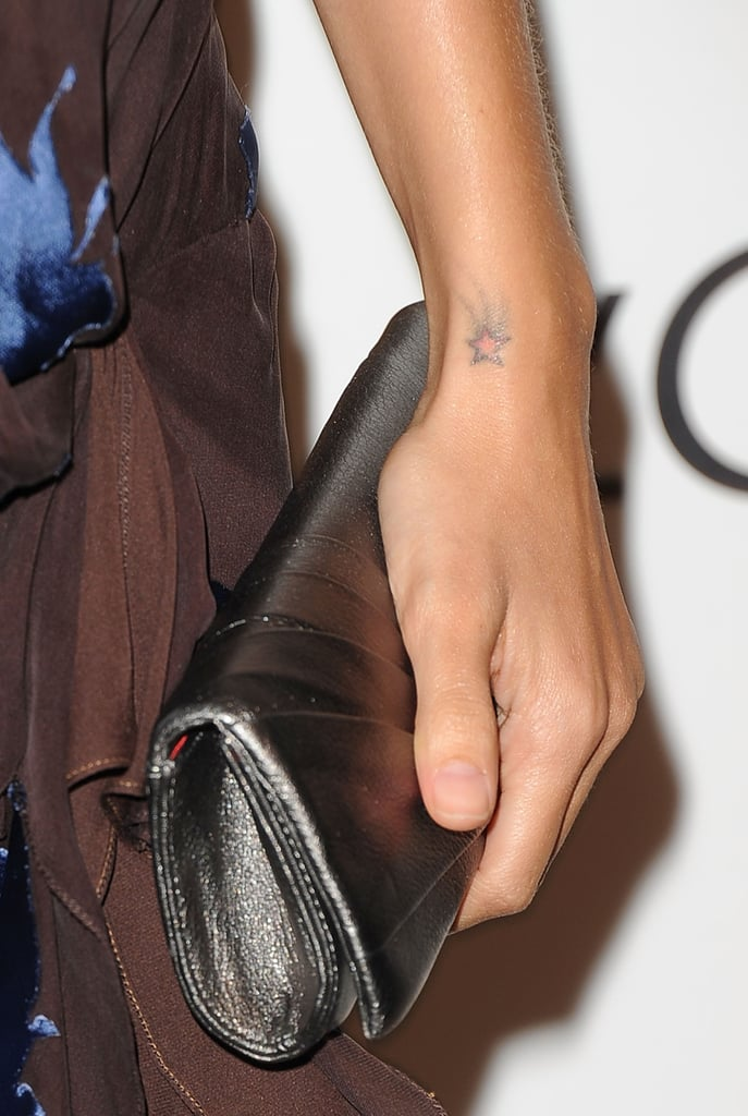 Nicole has a pink shooting star inked on her left wrist.