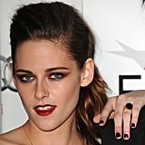 Kristen opted for smoldering eye makeup and burgundy lipstick to up the ante on her attention-getting look. In fact, the drama extended right down to her manicure and coordinating ring.