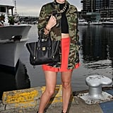 A camo-print jacket juxtaposed a brilliant poppy-hued skirt in this punky mix.