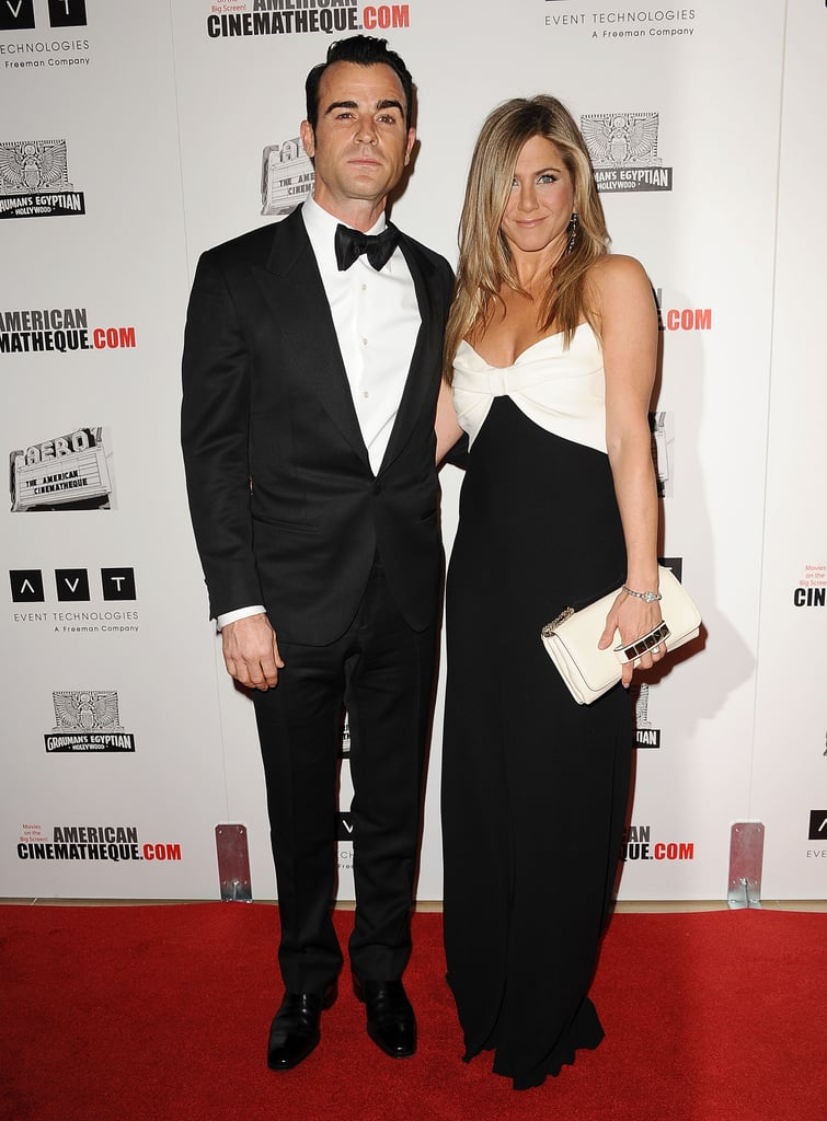 The couple showed off their coordinating black and white ensembles while attending an award presentation in 2012.