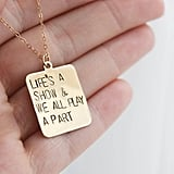"""Once More With Feeling"" Life's a Show Necklace ($32-$42)"