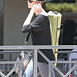 Charlize Theron sported a fedora with her newly buzzed hairstyle in LA.