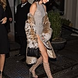 Kendall showed off her shoulders — and her thigh-high slit! — by letting her leopard fur coat hang away from her body. She also carried a small black Givenchy bag.