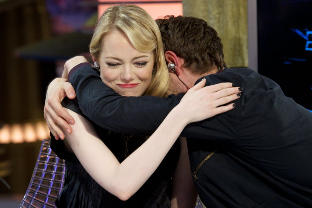 Andrew wrapped his arms around Emma during a July 2012 visit to the Spanish TV show El Hormiguero in Madrid.