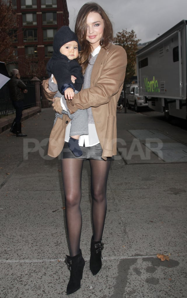 """Miranda Kerr and her son Flynn Bloom left their NYC hotel together last night. The supermodel-and-son duo have been in the Big Apple for the past month as she takes care of a variety of work assignments. First up was the annual Victoria's Secret fashion show, which took place on Nov. 9 and airs on CBS the evening of Nov. 29. Also, Miranda did a Terry Richardson shoot and a recent day of work posing for Australian retailer David Jones. Despite the long hours, Miranda's having fun in the Big Apple. She recently tweeted a photo of a park and commented, """"Love NYC in the Winter!"""""""