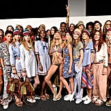 Gigi was the queen bee at the Tommy Hilfiger show, posing with the rest of the models backstage in her colourful suit and floral-print espadrille sneakers.