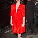 Jessica really turned up the volume in a red plunging dress and Christian Louboutin pumps en route to Saint Laurent's show at Paris Fashion Week.