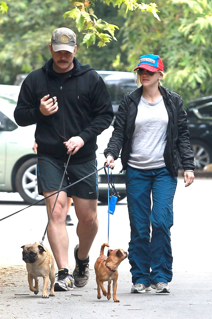 Anna Faris covered her pregnant belly under a sporty outfit while out for a walk around her LA neighborhood today. She was accompanied by her husband and soon-to-be dad, Chris Pratt, who was sporting a mustache, and their three dogs for the stroll. Anna and Chris shared the exciting news that they are expecting their first child last month, just before Anna began promoting her movie The Dictator. Anna's bump was barely visible in a bright red wrap dress at the London premiere of the film, in which she stars alongside Sacha Baron Cohen.