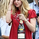 Amanda Seyfried clutched a bottle of Moët & Chandon at the US Open in September 2011.
