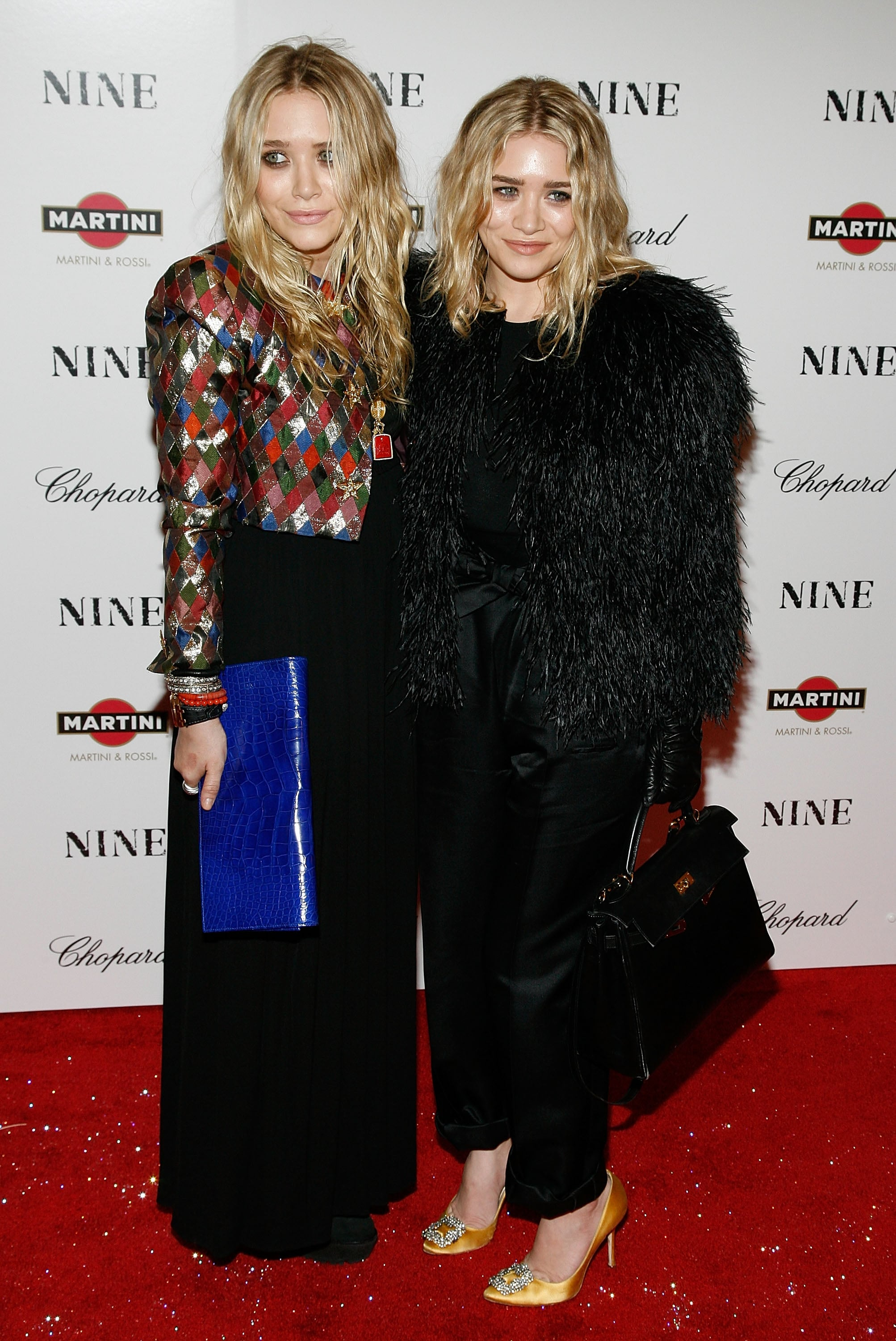 Twinning combo: Both girls wore eye-catching jackets and no-fuss beach waves for Nine's New York premiere in December 2009.   Mary-Kate brought major spunk in a shimmering harlequin jacket and cobalt leather clutch. Ashley proved all-black is anything but boring in a cropped feathered jacket, silk trousers, and slick leather gloves.