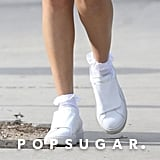 Selena let ruffled socks peek out from her Puma sneakers.