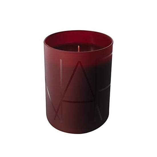 Nars's Shangri-La Candle ($50) has notes of clove bud, nutmeg, and basil leaves for a spicy, exotic scent that would add to any candle lover's collection.