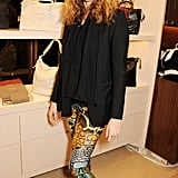 Lily Cole helped open the Longchamp flagship store in bold pants that she styled with a black topper.