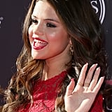 Sexy in red, Selena rocked classic lips and long red talon at the 2013 ESPY Awards recently. Her brunette locks looks soft with smooth curls.