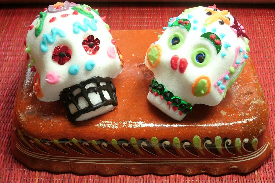 Tint homemade frosting with food coloring to decorate these skulls ...